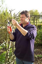 Alan Titchmarsh pruning an apple tree