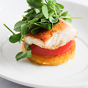 Seared halibut with local tomatoes, crisp polenta and pea shoots.