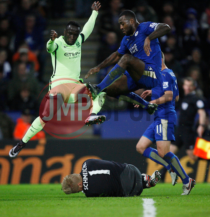 Kasper Schmeichel of Leicester City (C) saves from Bacary Sagna of Manchester City (L)  - Mandatory byline: Jack Phillips/JMP - 07966386802 - 29/12/2015 - SPORT - FOOTBALL - Leicester - King Power Stadium - Leicester City v Manchester City - Barclays Premier League