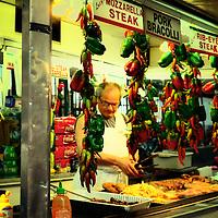 Street vendor at a market in Little Italy selling Italian specialties. Manhattan, New York City.