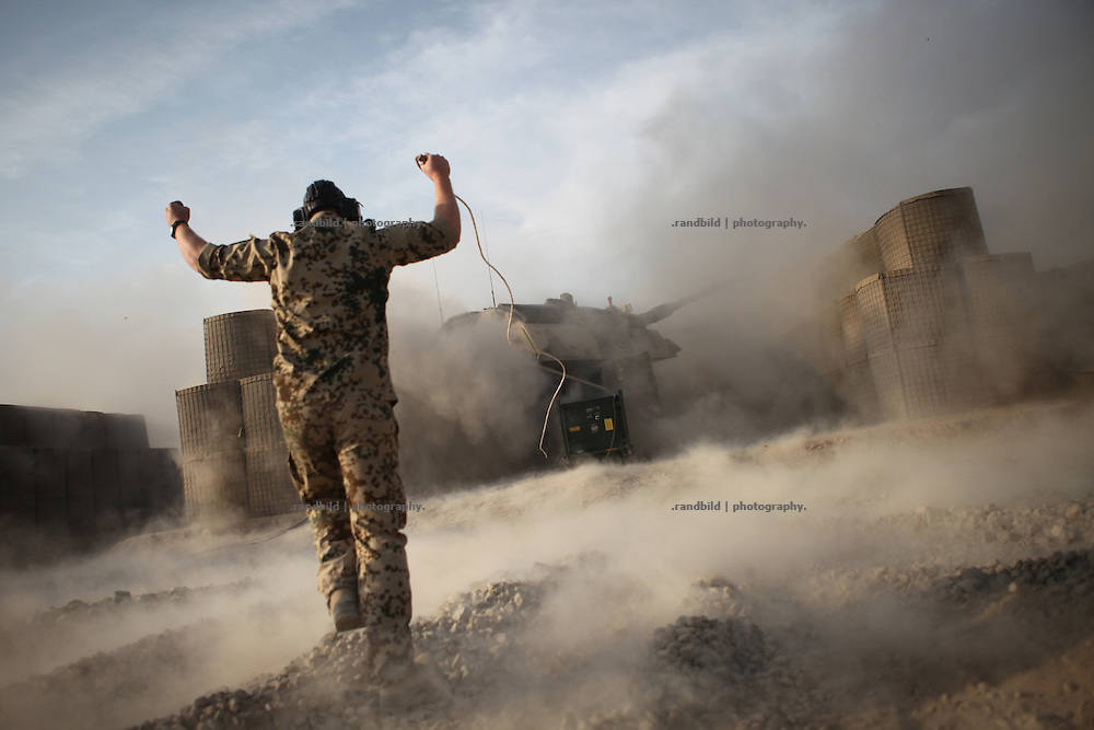 A Gunner gestures happily after he fired a Howitzer based in the PRT Kunduz for exercise reasons.