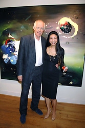 SIR TIM RICE and HSIAO-MEI LIN at a private view of her paintings held at the Adam gallery, 24 Cork Street, London on 28th April 2008.<br />