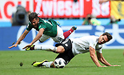 MOSCOW, RUSSIA - JUNE 17:  Miguel Layun of Mexico and Mats Hummels of Germany in action during the 2018 FIFA World Cup Russia group F match between Germany and Mexico at Luzhniki Stadium on June 17, 2018 in Moscow, Russia. , <br /> Football World Cup Russia 2018 - Germany vs Mexico 0:1, <br /> Football World Cup match in MOSCOW on June 17th 2018, Fussball-WM in Moskau, Deutschland - Mexiko, <br /> Honorarpflichtiges Foto, Fee liable image, Copyright &copy; ATP Amin JAMALI