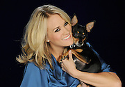 Nashville, TN, January 14, 2010 - Country star Carrie Underwood holds her dog Ace during the taping of a PSA for Pedigree. (Photo by Diane Bondareff)