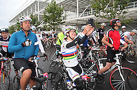 {Prudential RideLondonSurrey100. Chef John Torode ready for the off with Marianne Vos taking a selfie}<br /> Prudential RideLondon, the world's greatest festival of cycling, involving 70,000+ cyclists – from Olympic champions to a free family fun ride - riding in five events over closed roads in London and Surrey over the weekend of 9th and 10th August. <br /> <br /> Photo: Roger Allen for Prudential RideLondon<br /> <br /> See www.PrudentialRideLondon.co.uk for more.<br /> <br /> For further information: Penny Dain 07799 170433<br /> pennyd@ridelondon.co.uk