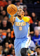 Nov. 12, 2012; Phoenix, AZ, USA; Denver Nuggets guard Andre Iguoldala (9) passes the ball in the game against the Phoenix Suns during the first half at US Airways Center. Mandatory Credit: Jennifer Stewart-US PRESSWIRE