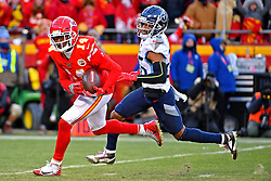 Jan 19, 2020; Kansas City, Missouri, USA; <br /> Kansas City Chiefs wide receiver Sammy Watkins (14) catches a touchdown  against Tennessee Titans cornerback Logan Ryan (26) during the second half in the AFC Championship Game at Arrowhead Stadium. Mandatory Credit: Denny Medley-USA TODAY Sports
