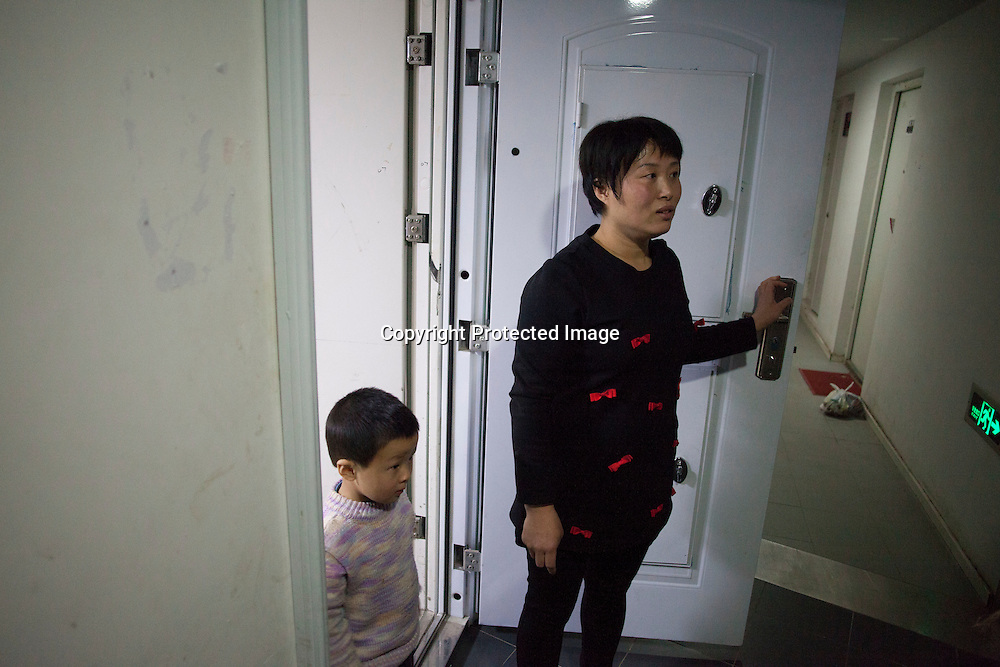Beijing, March 11 : Tian Peng, 15, lies on the sofa while his mother Cui Xinying and his younger brother Tian Ye, 3, see off visitors.<br /> As a baby Tian Peng fell ill with brain   hemorrhage supposedly due to a lack of vitamin K. When Tian Peng was a kid, friends advised the parents to simply abandon him as there's neither enough help nor support in China apart from a small NGO. Tian is unable to speak, think, walk and needs help for everything.<br /> Chinese attitudes towards people with disabilities have improved in recent years, but the support of society and opportunities in education and employment are scarce.