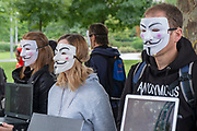 Members of the activist collective Anonymous for Voiceless, an animal rights organization specialized in street activism, demonstrate in London on August 26, 2018. the protesters held signs reading Truth and held laptops showing movies revealing violence against animals.