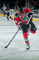KELOWNA, CANADA - SEPTEMBER 20: Tate Coughlin #18 of Kelowna Rockets takes a shot during warm up against the Kamloops Blazers on September 20, 2014 at Prospera Place in Kelowna, British Columbia, Canada.   (Photo by Marissa Baecker/Shoot the Breeze)  *** Local Caption *** Tate Coughlin;