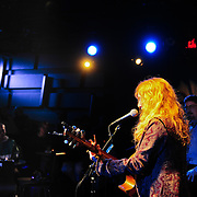 Singer Patty Larkin performs live at The Loft in Portsmouth, NH. Host Bob Lord in background.