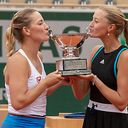 PARIS, FRANCE June 09.  Timea Babos of Hungary and Kristina Mladenovic of France celebrate with the trophy after winning the Women's Doubles Final against Saisai Zheng and Yingying Duan of China on Court Philippe-Chatrier at the 2019 French Open Tennis Tournament at Roland Garros on June 9th 2019 in Paris, France. (Photo by Tim Clayton/Corbis via Getty Images)