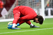 Alisson Becker (1) of Liverpool showing off his flexability during the warm up ahead of the Premier League match between Bournemouth and Liverpool at the Vitality Stadium, Bournemouth, England on 7 December 2019.