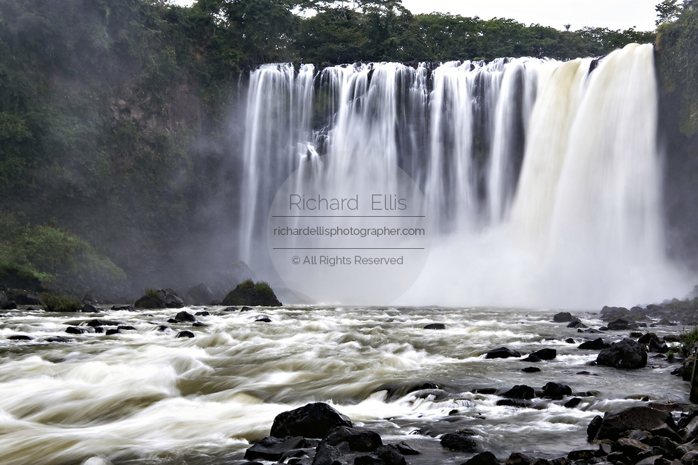 The massive Eyipantla Falls where the Catemaco River drops 50-meters to the lower jungle near San Andres Tuxtlas, Veracruz, Mexico. The waterfall is 40-meters wide and 50-meters tall.