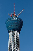 Tokyo Sky Tree under construction. Tokyo, Japan. Monday June 21st 2010. In this image the unfinished telecommunication tower stands at 398 metres high, Upon completion it will measure 634 metres from top to bottom, becoming the tallest structure in East Asia.