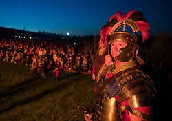 © Licensed to London News Pictures. 05/05/2018. Chalton, UK. An historic re-enactor dressed as a Roman soldier watches with the audience as a 30 foot high Wickerman is burnt at The Beltain Festival at Butser Ancient Farm in Hampshire. Over two thousand people gathered to witness the ancient Beltain Celtic celebration of summer - which will culminates in the burning of the giant Wickerman.  Photo credit: Peter Macdiarmid/LNP