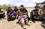 A six-year-old girl and her aunt, along with other illegal immigrants from Mexico, wait to be deported after they were apprehended by the U.S. Border Patrol east of Sells, Arizona on the Tohono O'odham Nation.  This area has the highest death rate of illegal border crossers in the nation.  The group walked for over two days in heat exceeding 110 degrees.