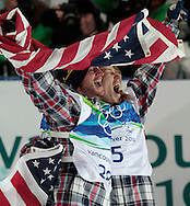 Unites States' Shaun White (R) and teammate Scott Lago hold up the American flag after winning medals in the men's halfpipe snowboard final at the 2010 Winter Olympics at Cypress Mountain in West Vancouver, Canada on February 17, 2010. White took the gold while Lago grabbed the bronze in the event.  (UPI)