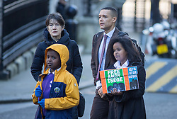 "© Licensed to London News Pictures. 29/11/2016. London, UK. Yilak Andargachew, Menabe Andargachew, Clive Lewis MP and Dame Harriet Walter bring a petition to Downing Street calling on the Prime Minister to seek the release of British man Andargachew ""Andy"" Tsege, who is in his sixties, who is in prison in Ethiopia under the shadow of a death sentence. Andargachew Tsegehas been detained in the country since he was removed from an airport in Yemen in June 2014. The father-of-three, who fled the country in the 1970s and sought asylum in the UK in 1979, had been a prominent critic of Ethiopia's ruling party. Photo credit : Tom Nicholson/LNP"