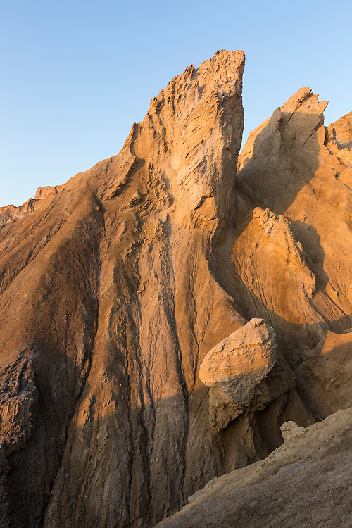 Israel, Morning sun lights jagged cliffs in Judean Desert above Dead Sea near Ein Gedi