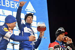 March 23, 2018 - Harelbeke, Belgium - Belgian Philippe Gilbert of Quick-Step Floors, Dutch Niki Terpstra of Quick-Step Floors and Belgian Greg Van Avermaet of BMC Racing Team celebrate on the podium, drinking Kwaremont beer, after the 61st edition of the 'E3 Prijs Vlaanderen Harelbeke' cycling race, 206,5 km from and to Harelbeke. (Credit Image: © Eric Lalmand/Belga via ZUMA Press)
