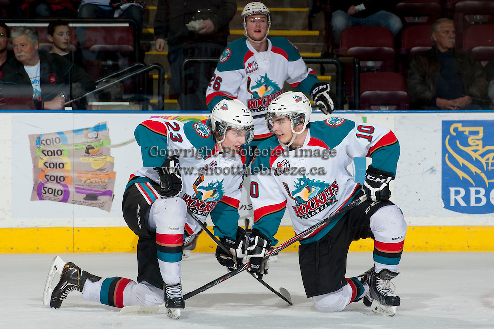 KELOWNA, CANADA - MARCH 28: Justin Kirkland #23 and Nick Merkley #10 of the Kelowna Rockets warm up on the ice at the start of game 5 against the Tri-City Americans of the first round of WHL playoffs on March 28, 2014 at Prospera Place in Kelowna, British Columbia, Canada.   (Photo by Marissa Baecker/Shoot the Breeze)  *** Local Caption *** Justin Kirkland; Nick Merkley;