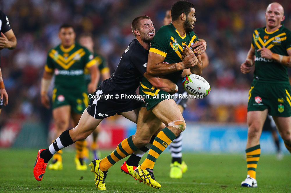 Greg Inglis is tackles by Kieran Foran during the Four Nations test match between Australia and New Zealand at Suncorp Stadium,  Brisbane Australia on October 25, 2014.