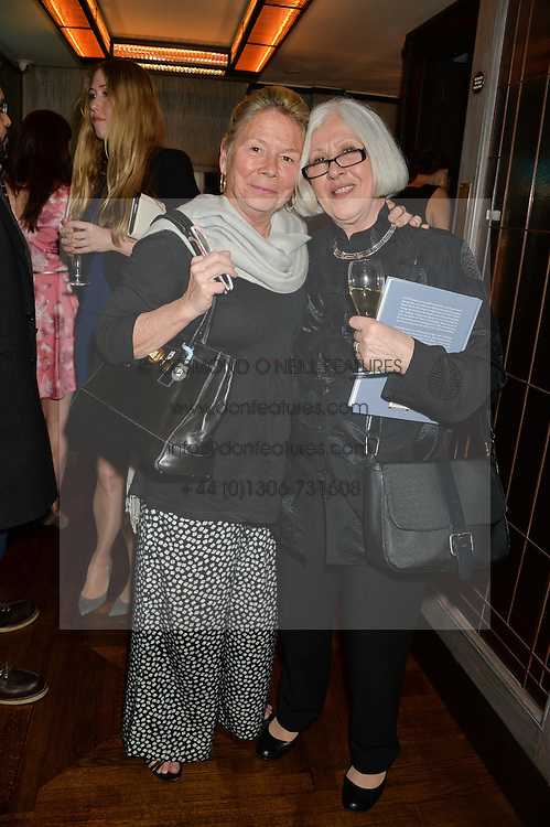 Left to right, LADY MOSS and MAGGIE KOUMI at a party to celebrate the publication on 'Just One More - A Photographers Memoir' by Gemma Levine held at 34, South Audley Street, London on 7th April 2014.