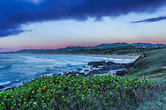 Heather at the Headlands at Woolgoolga, NSW, Australia, at sunrise on April 22, 2016, overlooking the back beach. There is a pink glow visible to the west from the Belt of Venus effect.<br /> <br /> This is a high-dynamic range stack of 5 exposures, stacked and tone-mapped in Adobe Camera Raw.