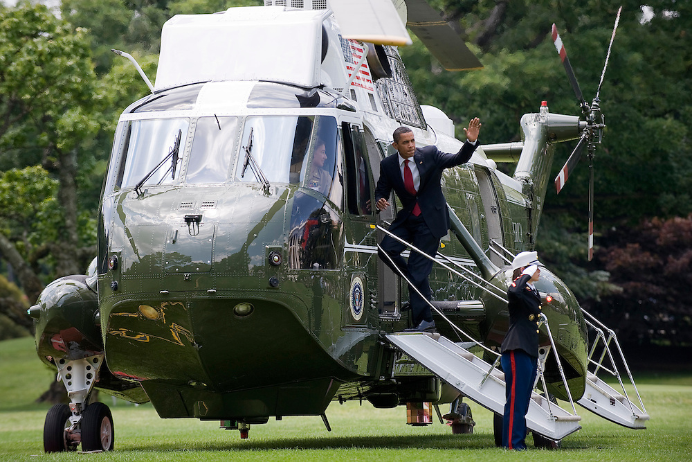 US President Barack Obama waves as he boards the Marine One helicopter, flown by an all female crew, on the south lawn of the White House in Washington DC, USA, 16 July 2009. Marine One's  Pilot Major Jennifer Grieves, the first female to pilot a Marine One helicopter, is at the end of her rotation and this flight is her last aboard the Presidential aircraft. Major Grieves was designated a Marine One pilot in May 2008 and has flown former President Bush and President Obama on numerous occasions. At the base of the steps is Crew Chief Sergeant Rachael Sherman.