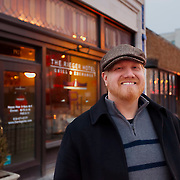 Ryan Maybee, co-owner of Rieger Whiskey Co. and Rieger Hotel Grill & Exchange standing in front of his establishment at about 19th & Main Streets, downtown Kansas City, Missouri.