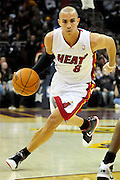 Dec. 2, 2010; Cleveland, OH, USA;  Miami Heat point guard Carlos Arroyo (8) drives toward the lane during the first quarter of the game against the Cleveland Cavaliers at Quicken Loans Arena. Mandatory Credit: Jason Miller-US PRESSWIRE