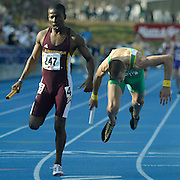 Arizona State's Lewis Banda, nips a diving Jeremy Wariner from Baylor by 1/100th of a second in the Drake Relays final event of the day, the 4 X 400 University Men's relay in 2003 in Des Moines, Iowa.   Wariner, a Baylor freshman, went on to win an Olympic Gold Medal the following year in the 400 meters at the summer Olympics in Athens, Greece.
