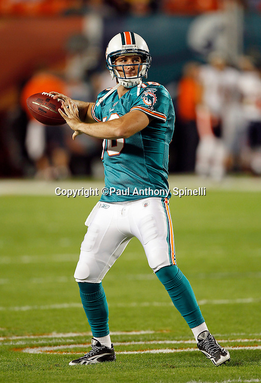 Miami Dolphins quarterback Tyler Thigpen (16) throws a pregame pass during the NFL week 11 football game against the Chicago Bears on Thursday, November 18, 2010 in Miami Gardens, Florida. The Bears won the game 16-0. (©Paul Anthony Spinelli)