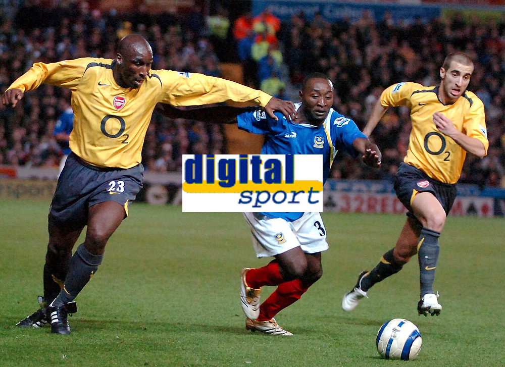 Photo: Ed Godden.<br />Portsmouth v Arsenal. The Barclays Premiership. 12/04/2006. Lomana Lua Lua (C) is pulled back by Arsenal's Sol Campbell.
