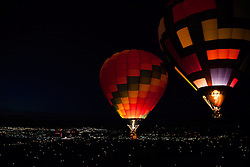 """Dawn Patrol 10"" - Photograph of glowing hot air balloons flying for the Dawn Patrol at the 2012 Great Reno Balloon Race. Photographed from a hot air balloon."