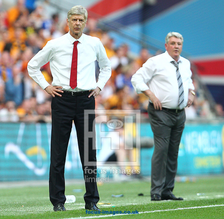 Arsene Wenger ( L ), Manager of Arsenal during the The FA Cup Final match at Wembley Stadium, London<br /> Picture by Paul Terry/Focus Images Ltd +44 7545 642257<br /> 17/05/2014