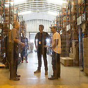 OCTOBER 6, 2017--PONCE, PUERTO RICO ---<br /> Allan Cintron Salichs, left, Executive Director of Med Centro in Ponce, leads Direct Relief's Damon Taugher and Daniel Ramos, from the Association de Salud Primaria de Puerto Rico, to an air conditioned storage facility on their property.<br /> (Photo by Angel Valentin/Freelance)