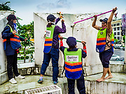 23 AUGUST 2017 - BANGKOK, THAILAND: Bangkok city workers scrub the walls of Pom Mahakan. Bangkok city officials this week started cleaning up the area around cremation site for Bhumibol Adulyadej, the Late King of Thailand. Work started by cleaning Pom Mahakan, a historic fort about two kilometers northeast of the cremation site. They are going to scrub and paint the fort's historic exterior walls, which were built in the late 18th century. The King, who died on 13 October 2016, will be cremated on 26 October 2017.      PHOTO BY JACK KURTZ