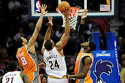 Jan. 19, 2011; Cleveland, OH, USA; Phoenix Suns center Channing Frye (8) and power forward Hakim Warrick (21) try to block Cleveland Cavaliers power forward Samardo Samuels (24) during the fourth quarter at Quicken Loans Arena. The Suns beat the Cavaliers 106-98. Mandatory Credit: Jason Miller-US PRESSWIRE