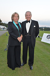 NICHOLAS & ANNIE COLQUHOUN-DENVERS he is chairman of Ham Polo Club at the Chovgan Twilight Polo Gala in association with the PNN Group held at Ham Polo Club, Petersham Close, Richmond, Surrey on 10th September 2014.