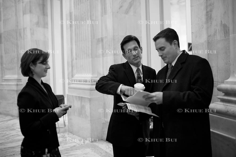 House Minority Whip Eric Cantor (R-VA) speaks with his Republican Whip Press Secretaries Megan Whittemore, left, and Brad Dayspring in between media interviews in the Russell Rotunda November 2, 2010, in Washington, DC.  Here, Cantor looks over a list of completed House races.  Sweeping victories by Republican House candidates leads to a change in party control of the US House...and Cantor is expected to become the next Majority Leader.  ****Image available in color and/or B&W****..Photo by Khue Bui