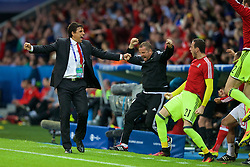 LILLE, FRANCE - Friday, July 1, 2016: Wales manager Chris Coleman celebrates his sides equalising first goal against Belgium, to level the score 1-1, during the UEFA Euro 2016 Championship Quarter-Final match at the Stade Pierre Mauroy. goalkeeping coach Martyn Margetson, goalkeeper Daniel Ward. (Pic by Paul Greenwood/Propaganda)