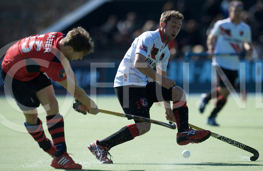 Amstelveen - Euro Hockey league KO16.Amsterdamse H&BC - Berliner HC.foto: Roc Oliva (white) and Martin Häner (red)..FFU PRESS AGENCY COPYRIGHT FRANK UIJLENBROEK.