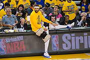 Golden State Warriors center JaVale McGee (1) stretches on the sidelines during a timeout against the Utah Jazz during Game 2 of the Western Conference Semifinals at Oracle Arena in Oakland, Calif., on May 4, 2017. (Stan Olszewski/Special to S.F. Examiner)