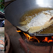 Frying fish outside of Can Tho, Vietnam.