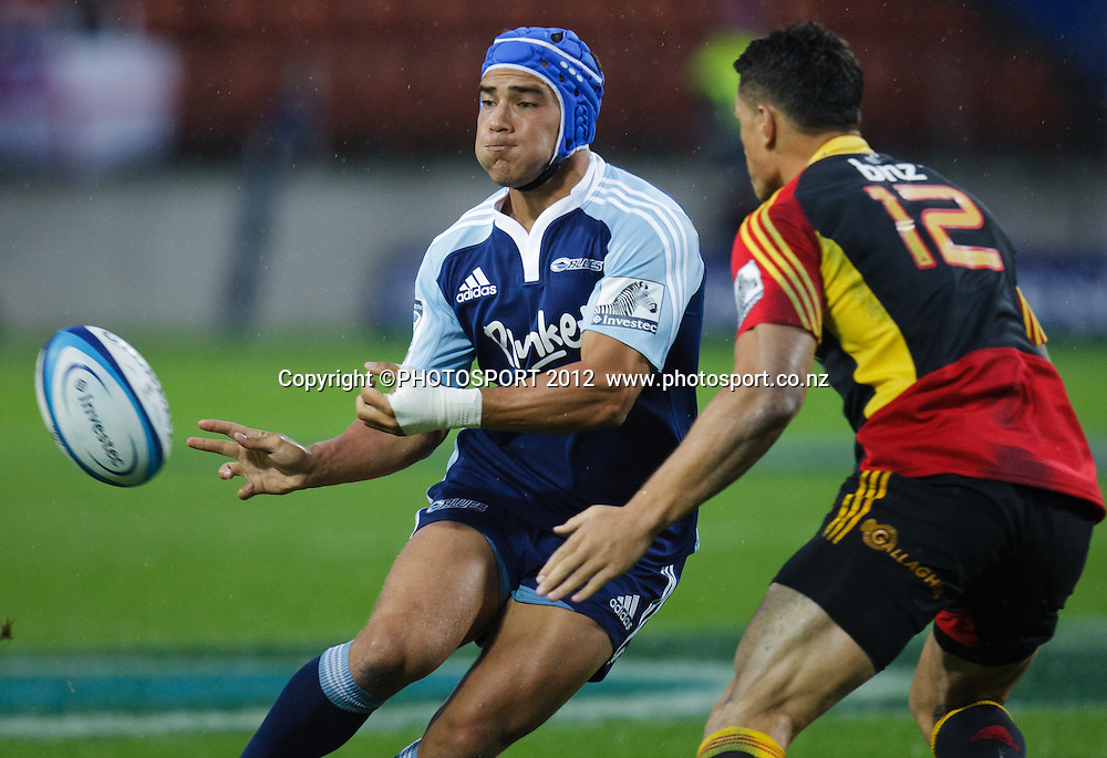 Blues' Benson Stanley passes with Sonny Bill Williams opposite during the 2012 Super Rugby season, Chiefs v Blues match at Waikato Stadium, Hamilton, New Zealand, Friday 2 March 2012. Photo: Stephen Barker/PHOTOSPORT