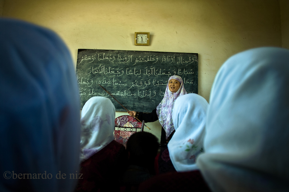 Muslim women learn to read in the west of China, in Ganzu province, China