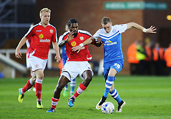 Peterborough United's Marcus Maddison in action with Crewe Alexandra's Anthony Grant - Photo mandatory by-line: Joe Dent/JMP - Mobile: 07966 386802 - 14/04/2015 - SPORT - Football - Peterborough - ABAX Stadium - Peterborough United v Crewe Alexandra - Sky Bet League One
