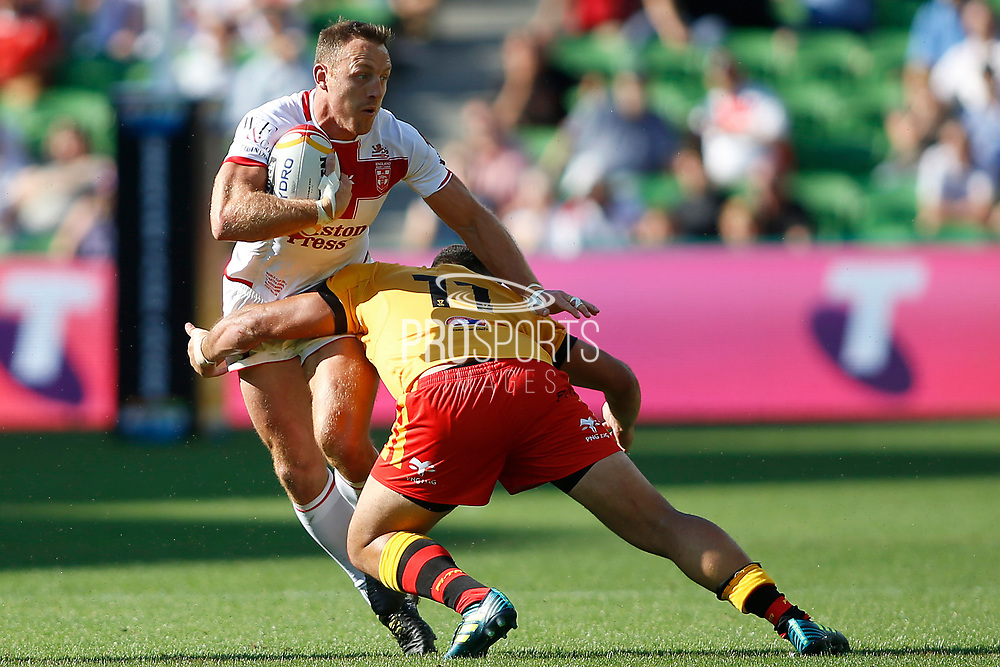 James Roby of England gets tackled by Rhyse Martin of Papua New Guinea  during the Rugby League World Cup Quarter-Final match between England and  Papua New Guinea at Melbourne Rectangular Stadium, Melbourne, Australia on 19 November 2017. Photo by Mark  Witte.